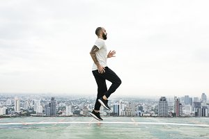 Man Exercising on The Rooftop