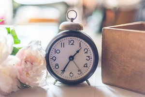 Antique alarm clock and flowers
