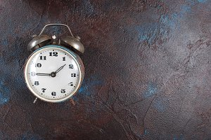 Antique rustic alarm clock