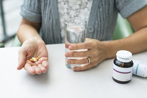 Woman about to take Medicines