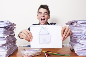 child with the drawing of the house