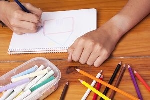 closeup of the hands of the child working in the school