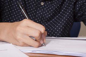 hand of the child writing on the paper