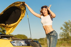 Girl repairing car