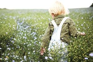 Little boy on spring field