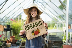 Cheerful woman with organic garden