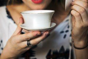 caucasian woman drinking tea