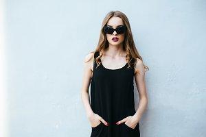 Attractive fashion woman in black dress