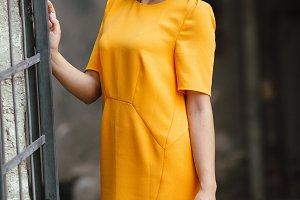 Attractive fashion woman in orange dress