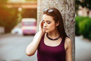 pretty girl sitting in a city street