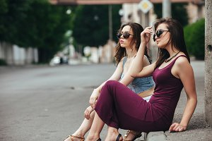 Two beautiful young girls posing in the city