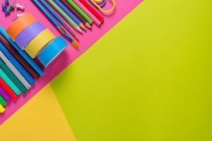 Stationery tools on colorful table