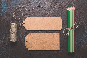 Craft tag and tools on background