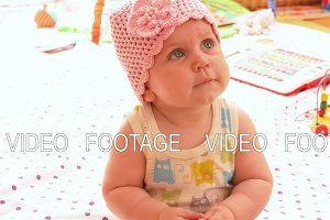 Baby in a pink knitted hat