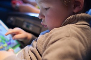 Kid playing on a tablet computer