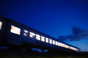 Illuminated train traveling past
