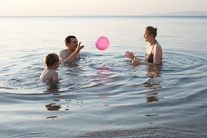 Young family playing with ball