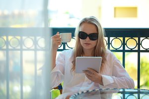 Woman sitting reading a tablet -pc