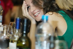 Happy smiling woman sitting at a bar