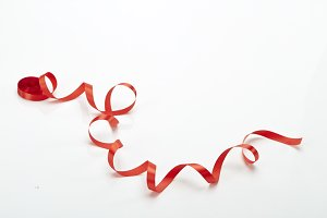 fabric red ribbon on a white Background