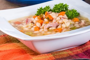 White bowl with bean soup