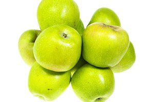 Green Pippin apples on white