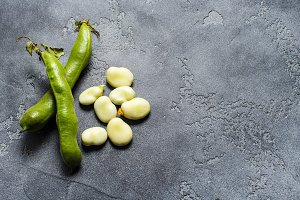 Green beans on grey table.