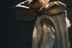 Fresh baked bread in hands