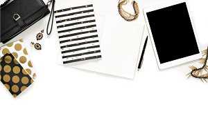 Flat lay photo of stylish office white desk with wallet, Women's jewelry, keyboard and gold notebook copy space background