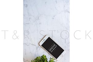 iPhone Mockup on Marble Desktop