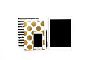 Flat lay photo of minimalistic white office desk with phone, tablet and stylish gold notebooks copy space background