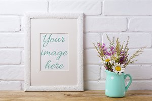 White frame mockup with chamomile