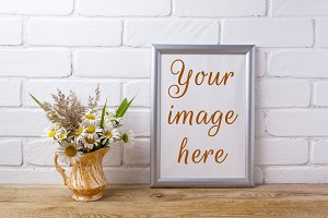 Silver frame mockup with chamomile