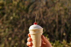 Hand holds ice cream