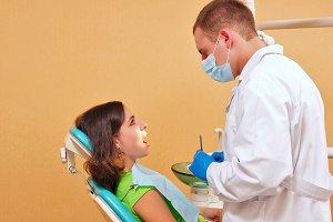 Girl on examination at dentist