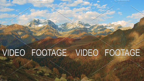 Golden Autumn Mountain Hills Snow Tops And Red Forest Cloud Shadows Show Relief Timelapse