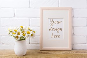 Wooden frame mockup with chamomile