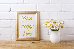 Golden  frame mockup with chamomile