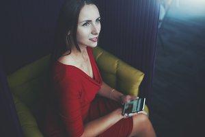 Businesswoman on fenced armchair