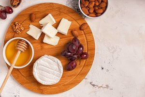 cheese, grapes, nuts and honey