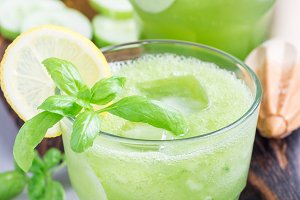 Healthy lemonade with cucumber, basil, lemon, honey and sparkling water, vertical
