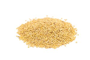 Heap of organic millet groats, sideview, isolated