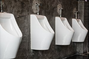 Row of Urinal in male restroom