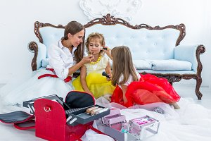 Mother and daughters doing makeup