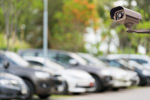 CCTV camera on blur car parking