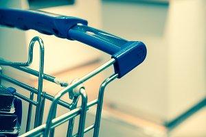 Shopping cart close up . Retro filte