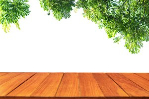 Wood table top on green leaf