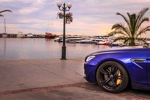 Sport car on the sand beach. Expensive, luxury car near the sea
