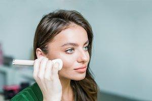 Woman applying cosmetic