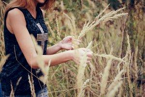 Girl having fun in summer field